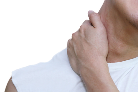 muscle relaxant: isolated man holding his neck in pain