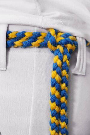 background of amarelo-azul capoeira cord  on the pants Banco de Imagens
