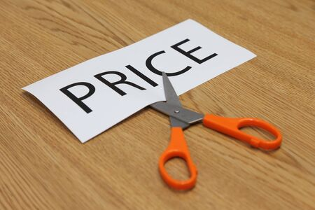 cut price: business concepts of scissor cut price tag Stock Photo