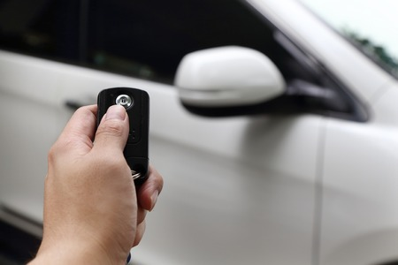close up on a hand using car key to open the car Archivio Fotografico