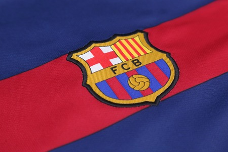 BANGKOK, THAILAND -JULY 30, 2015: the logo of Barcelona football club on an official jersey on July 30, 2015 in Bangkok Thailand. 新闻类图片