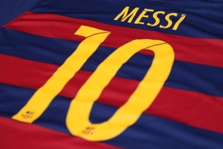messi: BANGKOK, THAILAND -JULY 30, 2015: the name of Lionel Messi of Barcelona on the back of official jersey on July 30, 2015 in Bangkok Thailand.
