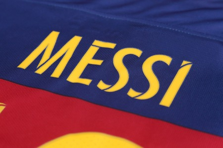 messi: BANGKOK, THAILAND -JULY 31, 2015: the name of Lionel Messi of Barcelona on the back of official jersey on July 31, 2015 in Bangkok Thailand.