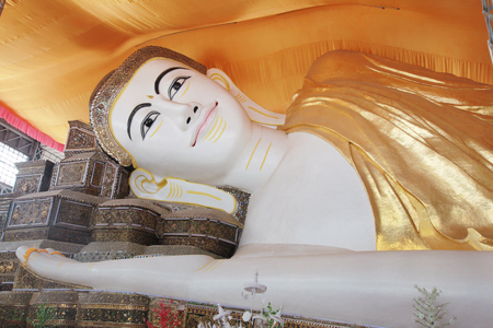 reclining: The giant reclining Buddha at Chaukhtatgyi temple in Yangon, Myanmar Stock Photo