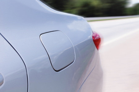 swerving: rear side of the speeding car with motion blur background Stock Photo