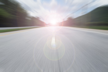 cars race: road with speed motion blur
