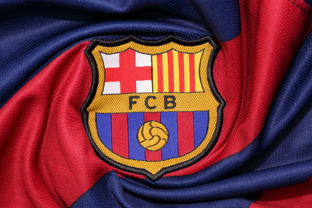 BANGKOK, THAILAND -AUGUST 30, 2015: the logo of Barcelona football club on an official jersey on August 30, 2015 in Bangkok Thailand.