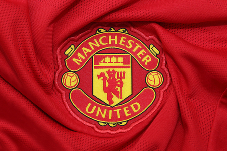 BANGKOK, THAILAND - AUGUST 30, 2015: the logo of the Manchester United football club on an official jersey on August 30,2015 in Bangkok Thailand.