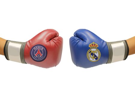 september 2: BANGKOK, THAILAND - SEPTEMBER 2, 2015: the logo of  Paris saint Germain and Real Madrid football club on the boxing glove on the on  September 2,2015 in Bangkok Thailand.
