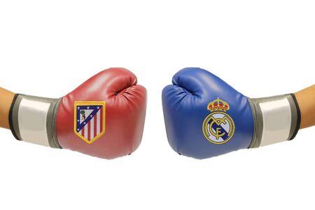 september 2: BANGKOK, THAILAND - SEPTEMBER 2, 2015: the logo of Atletico Madrid and Real Madrid football club on the boxing glove on the on  September 2,2015 in Bangkok Thailand. Editorial