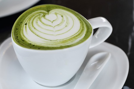 close up on a cup of matcha green tea latte