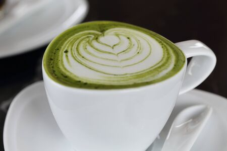 green powder: close up on a cup of matcha green tea latte