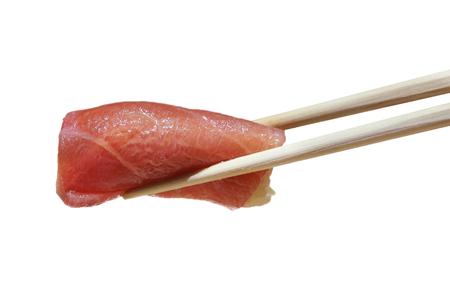 shu: isolated chopstick  holding  shu toro shushi on white background Stock Photo