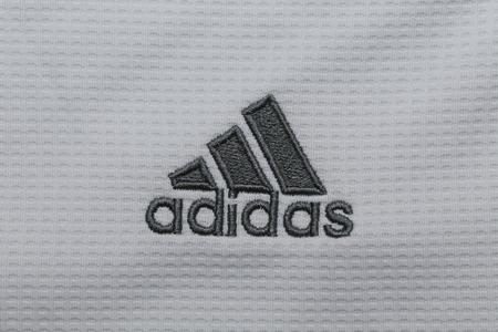 adidas: BANGKOK, THAILAND -OCTOBER 6, 2015:  the logo of Adidas brand on the football jersey on October 6, 2015 in Bangkok Thailand.