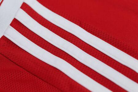 adidas: BANGKOK, THAILAND -OCTOBER 6, 2015:  the Adidas three stripes on the football jersey on October 6, 2015 in Bangkok Thailand.