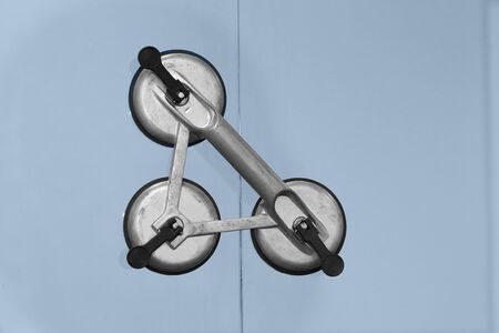 lifter: background of window glass connect with suction cup lifter