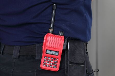 radio communication: red radio communication on the staff back Stock Photo