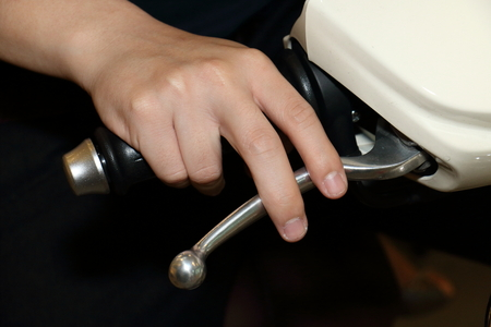 hand brake: background of hand on motorcycle brake Stock Photo