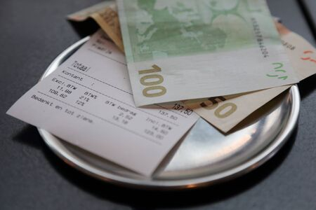 taxable: euro bank note payment for bill on on restaurant table