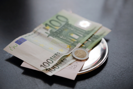euro bank note payment for bill on on restaurant table