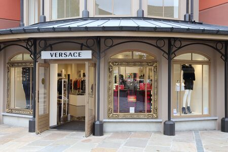 outlet store: BELGIUM - OCTOBER 17:  A Versace store in Maasmechelen Village outlet  on October 17, 2015.