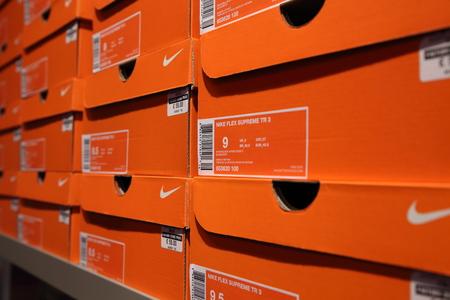 nike: BELGIUM - OCTOBER 17: Background of Nike shoes boxes at Maasmechelen Village outlet  on October 17, 2015.