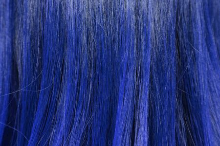blond streaks: close-up background of blue hair color
