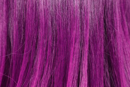 blond streaks: close-up background of pink hair color