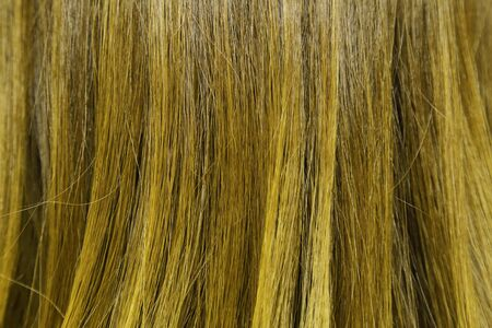 blond streaks: close-up background of yellow hair color