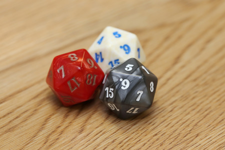 20 sides dice on the wooden table