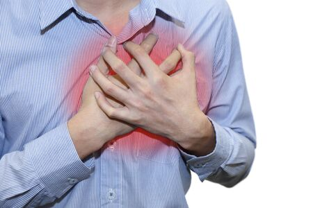 heartattack: isolated man having a heart attack grab his chest with pain