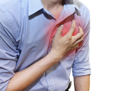 isolated man having a heart attack grab his chest with pain