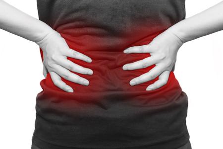 aislados mujer agarra la espalda debido a dolor de espalda