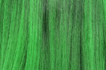 blond streaks: close-up background of green hair color