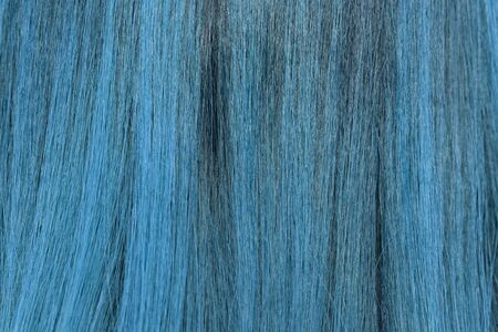 blonde streaks: close-up background of blue hair color
