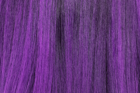 blonde streaks: close-up background of purple hair color