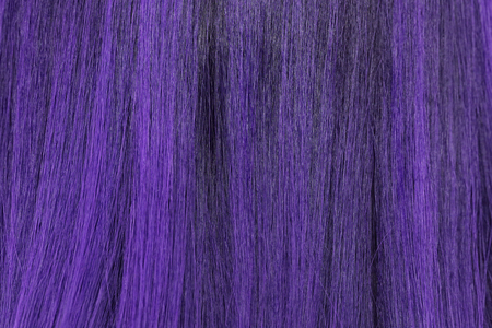 blond streaks: close-up background of purple hair color