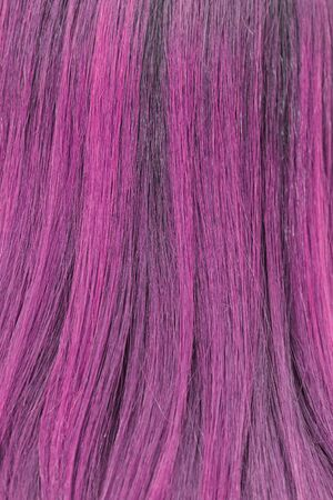 blonde streaks: close-up background of pink hair color