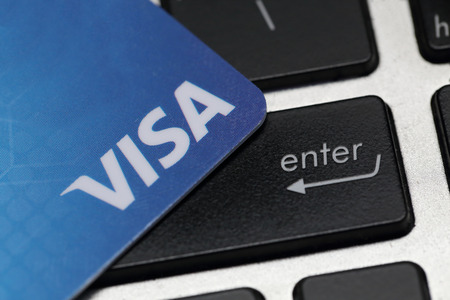 visa credit card: BANGKOK, THAILAND - JANUARY 10, 2016 : VISA credit card on laptop keyboard ready for online payment on January 10,2016 in Bangkok Thailand. Editorial