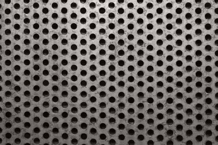 perforated: background of rusty metal with seamless perforated holes