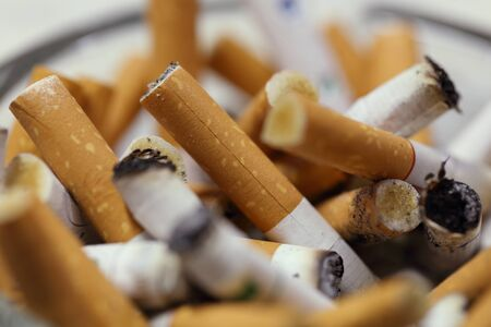 ciggy: close-up on used cigarette in an ashtray