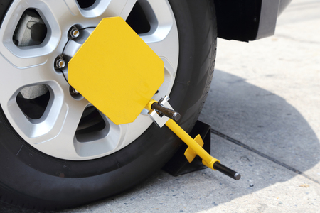 clamp: clamped front wheel with yellow wheel lock