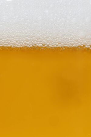 close-up background of beer in the glass