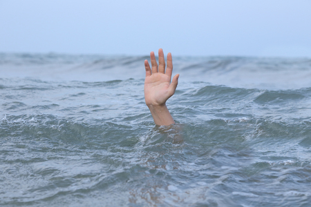 drowning: hand drowning in the sea Stock Photo