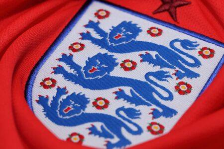 football jersey: BANGKOK, THAILAND - MAY 27, 2016: The Three Lions Logo from England National Football  Jersey on May 27,2016 in Bangkok Thailand.