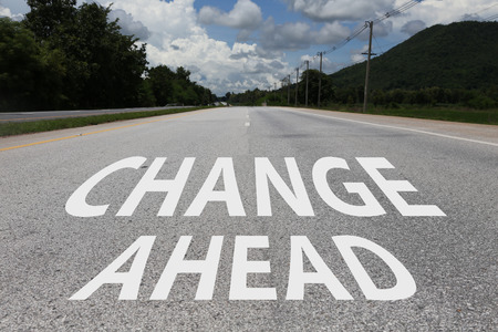 arduous: business concept of change ahead sign on the road