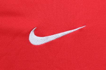 nike: BANGKOK, THAILAND - JUNE 6, 2016: the logo of Nike brand on the football jersey on June 6,2016 in Bangkok Thailand.