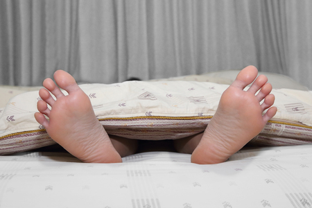 duvet: close up on feet cover in a bed duvet Stock Photo