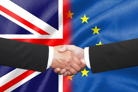 two business man shakehand with uk and eu flag as a background Reklamní fotografie