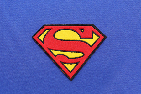 BANGKOK, THAILAND -JULY 3, 2016: Superman Logo on Blue Fabric on July 3,2016